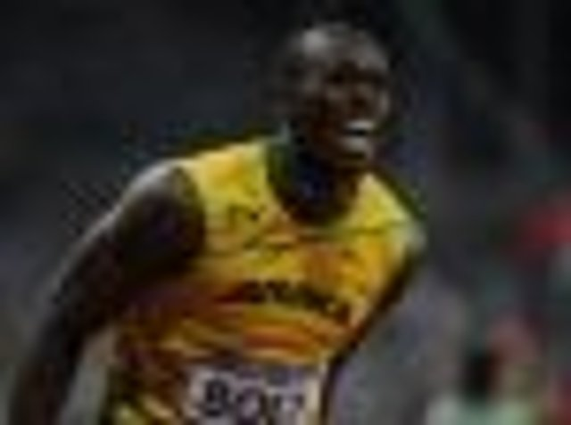 Usain Bolt laps it all up after Olympic sprint double joy ...