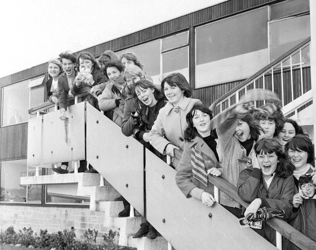 The Beatles arrive at Turnhouse in 1964. Beatles fans wait at the airport.