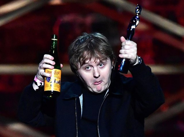 Lewis Capaldi accepts hte Song of the Year award with a bottle of Buckfast in hand. Picture: Gareth Cattermole / Getty Images