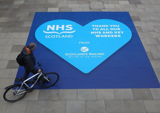 This tribute to the NHS at Waverley Station is another visibile reminder of the impact of the virus (Picture:: Andrew Milligan/PA Wire)