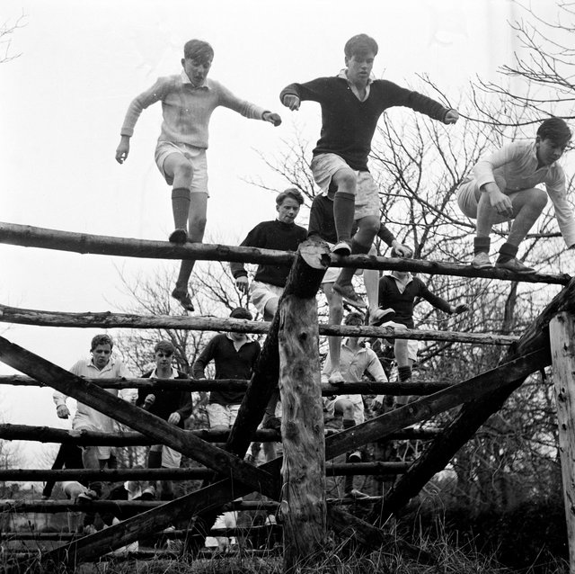 7th February 1956:  Pupils at Gordonstoun School doing physical training on an obstacle course. Gordonstoun School, near Elgin, was founded in 1934 by German educationalist Kurt Hahn who believed in a holistic approach to teaching. Creative and personal development, considered of equal merit to traditional education, is encouraged among the pupils.  (Photo by Chris Ware/Keystone Features/Getty Images)
