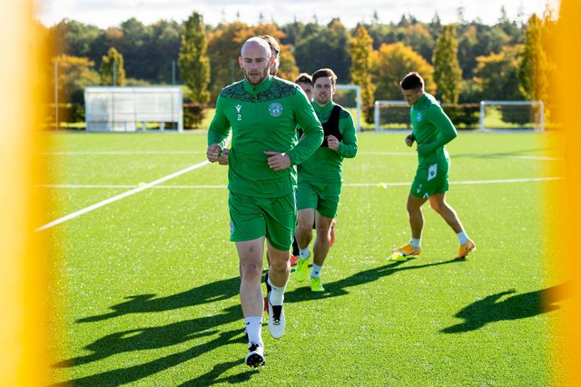 David Gray leads the way at training at East Mains. The Hibs captain says he feels as fit as he ever has and hasn't missed one training session