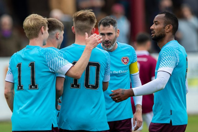 Hearts players' including Loic Damour (right) celebrate Finlay Pollock's opener in the friendly win over Linlithgow Rose at Prestonfield (Photo by Craig Brown / SNS Group)