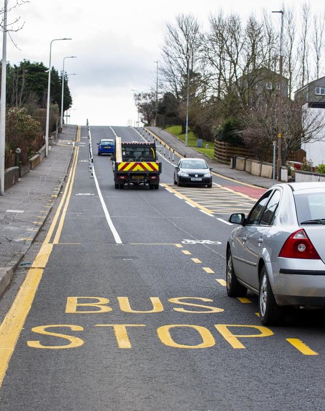 New road marking looking up Drum Brae North restrict traffic flow     Drum Brae North Bus Stop