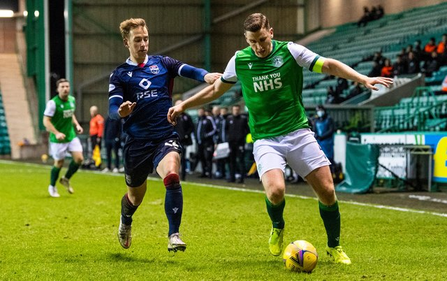 Paul Hanlon of Hibs holds off Ross County's Harry Paton during the last encounter between the two teams