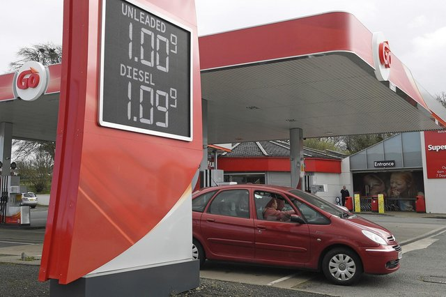 The price of petrol displayed at a fraction of a penny over £1/litre at Moran's filling station in Ballykelly, County Londonderry, as the effects of the economic slowdown caused by the coronavirus weighs down global oil prices.