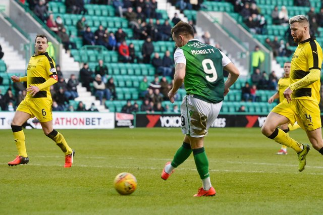 Marc McNulty scores for Hibs against Raith in the lat competitive meeting between the two sides as Iain Davidson, right, looks on
