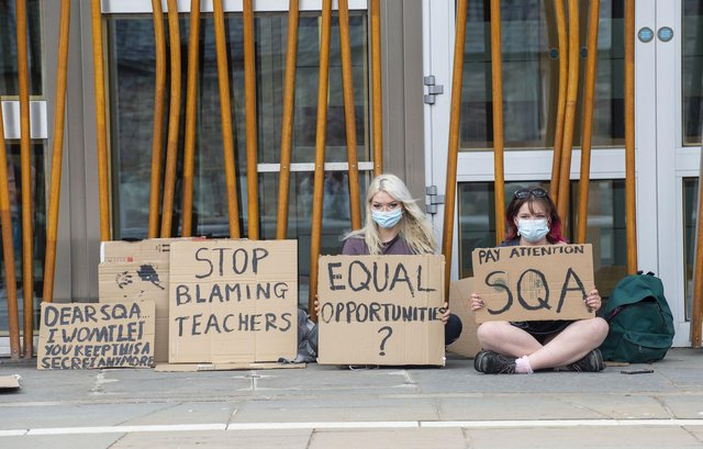 Pupils protesting outside the Scottish Parliament over exams    Picture: Lisa Ferguson      COVID 19  - A COUPLE OF STUDENTS PROTEST OUTSIDE THE SCOTTISH PARLIAMENT THIS AFTERNONN WITH REGARDS TO EXAMS