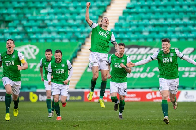 Jackson Irvine leaps highest as Hibs celebrate winning the penalty shoot-out.