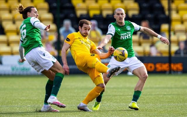 Jackson Irvine and Alex Gogic keep tabs on Scott Pittman