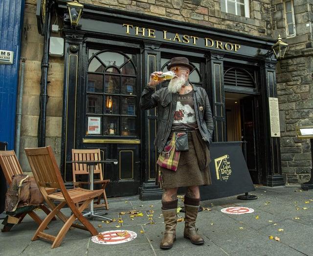 Douglas Barr drinks his pint outside The Last Drop on the Grassmarket. Picture: Lisa Ferguson