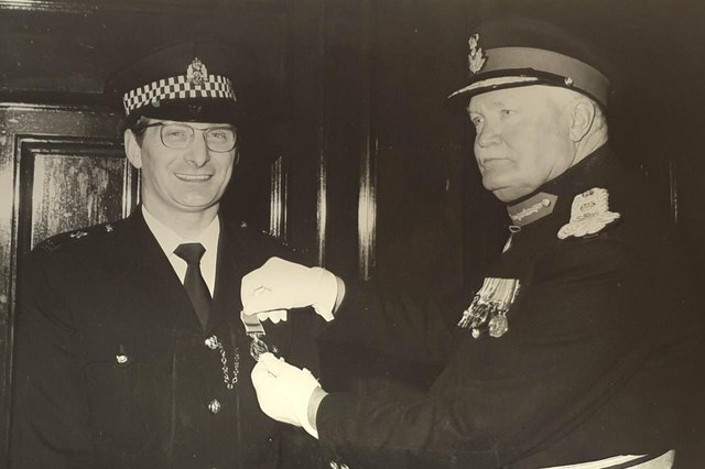 Sandy Marr being presented with the British Empire Medal by Lord Kilmany on April 7, 1977.