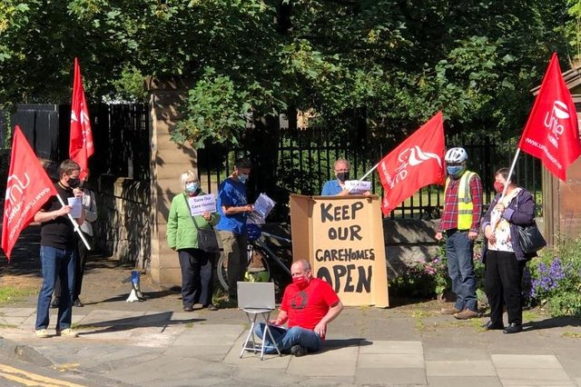 Members of Unite the union and campaign group Another Edinburgh is Possible demonstrate outside Ferrylee care home as Unite's Brian Robertson (seated) presents their case to the board