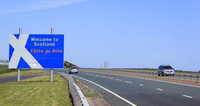 'Welcome to Scotland' sign at the border between England and Scotland.