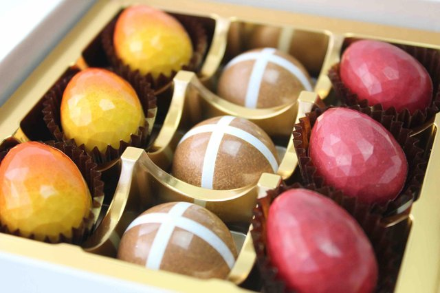 Chocolatier Sebastian Kobelt's nine piece Easter box contains yellow praline eggs, salted caramel eggs and hot-cross bun chocolates. www.sebastainkobelt.com
