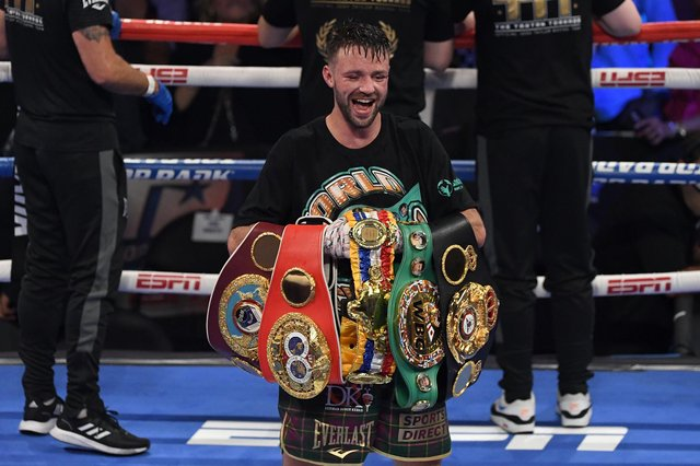 Josh Taylor with an armful of belts following his triumph at the weekend