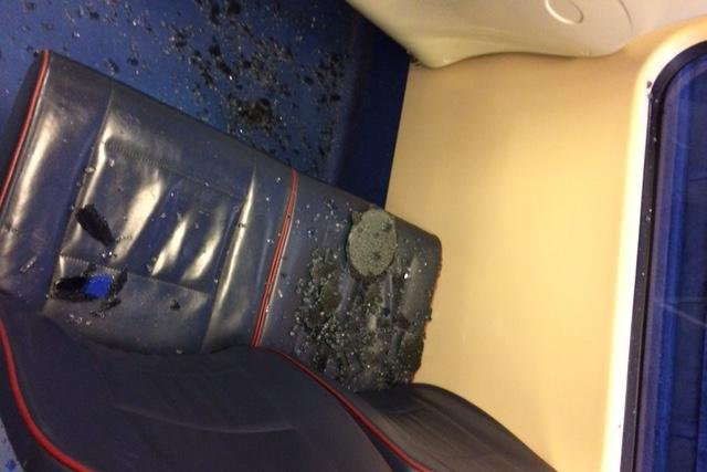 Images sent to the Evening News show glass strewn across seats on an Edinburgh Tram after a 'rock' was thrown at the window