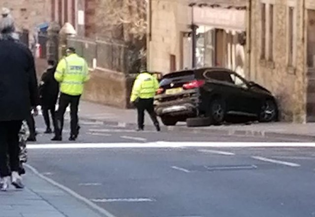 The crash happened in the Canongate on Wednesday morning.