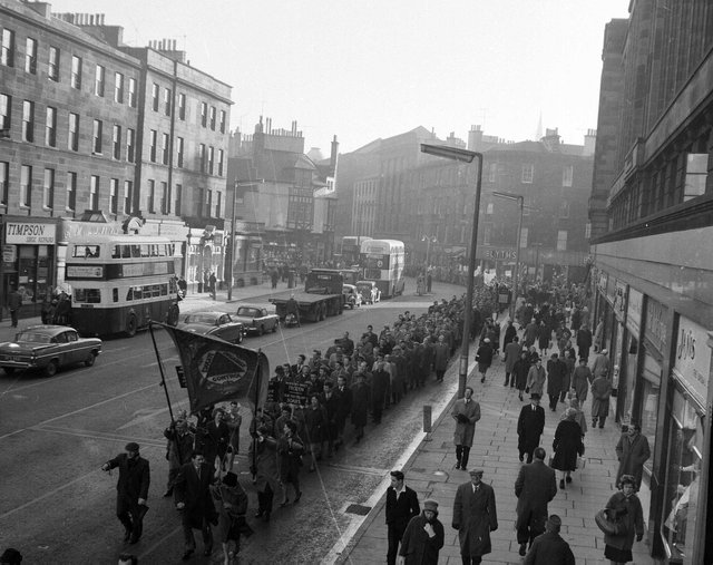 In a very different kind of procession, shipbuilding and engineering unions are pictured marching down Lothian Road during a one day strike in Edinburgh in 1962.
