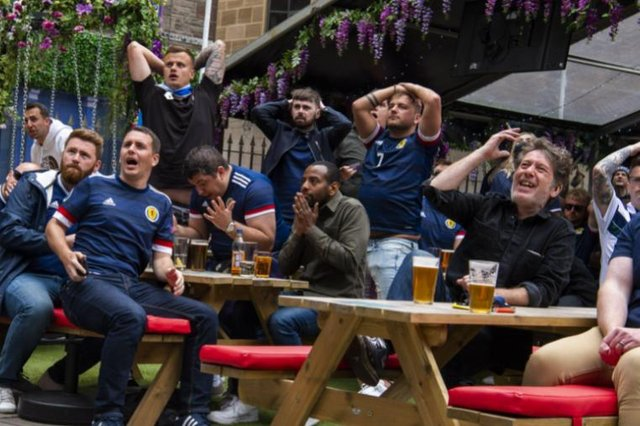 These 13 pictures show fans in Edinburgh reacting to Scotland's first Euro 2020 match.