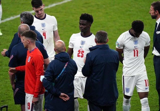 England manager Gareth Southgate stands dejected alongside Bukayo Saka and Jack Grealish following the UEFA Euro 2020 Final at Wembley Stadium, London picture: Mike Egerton
