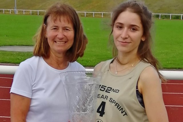 Molly Renshaw, with coach Linda Nicholson, after her New Year Sprint 2021 triumph