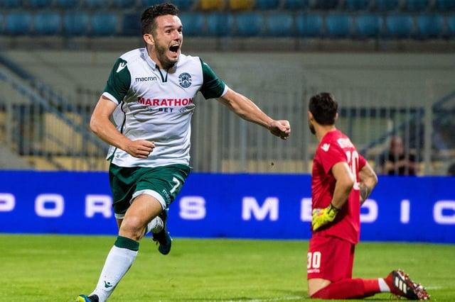 John McGinn celebrates after scoring a vital away goal in Tripoli. Picture: SNS