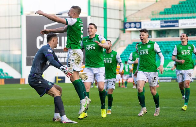 Hibs' goalkeeper Matt Macey prepares to ceebrate with Ryan Porteous after the defender scores the winning penalty in in the shoot out with Motherwell. Photo by Ross Parker / SNS Group