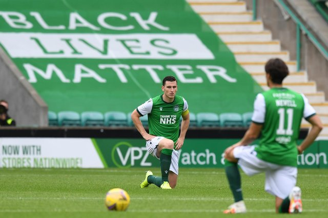 Hibs Paul Hanlon and Joe Newell take the knee as part of the ongoing battle against racism. Photo by Craig Foy / SNS Group