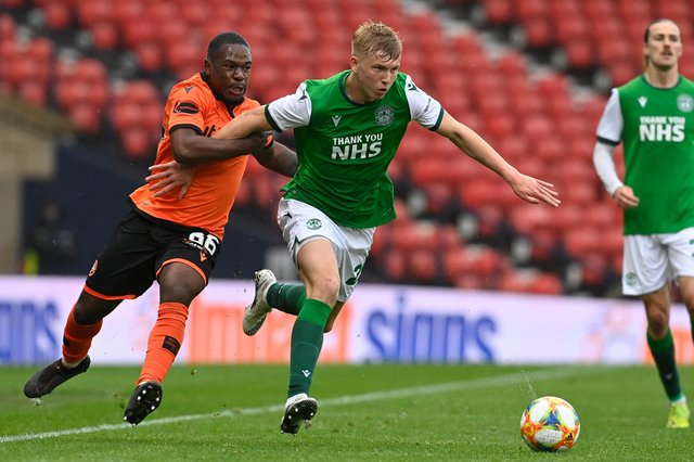 Josh Doig of Hibs tries to give Dundee United midfielder Jeando Fuchs the slip at Hampden