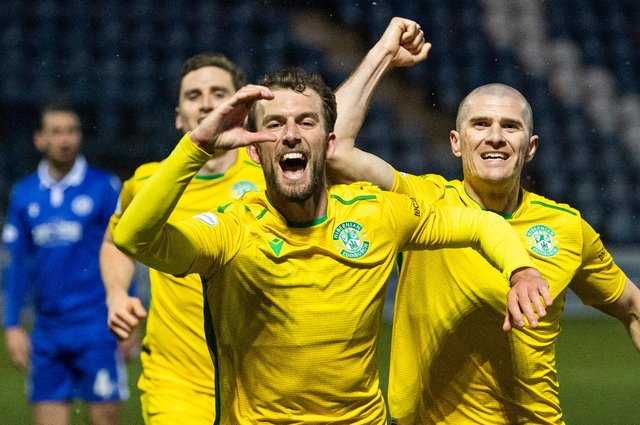 Christian Doidge celebrates his opener with a tribute to Lee Collins