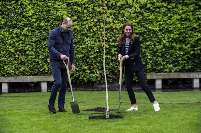 Prince William and Kate planted the first tree for the St Andrews Forest, one of the key initiatives in the university's action plan to become carbon neutral by 2035 (Picture: Andy Buchanan/PA)
