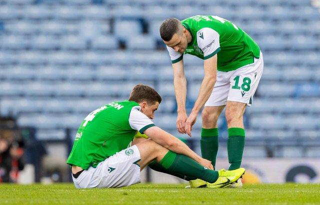 Jamie Murphy attempts to console Paul Hanlon at full time following St Johnstone's 1-0 win against Hibs in the Scottish Cup final