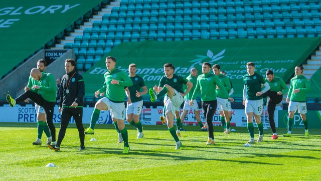 Hibs players warm up ahead of the 2-1 win over Livingston that clinched European football next season. (Photo by Mark Scates / SNS Group)