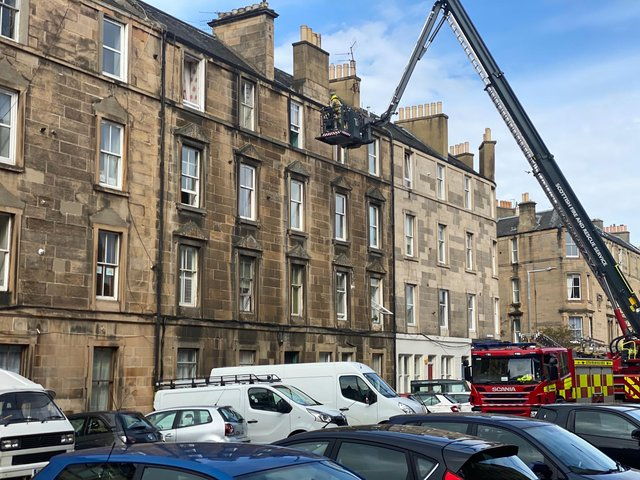 Fire engine cherry picker with fire officer seen helping evacuate residents from flat building on Iona Street in Leith (Photo: Alexis Woods).