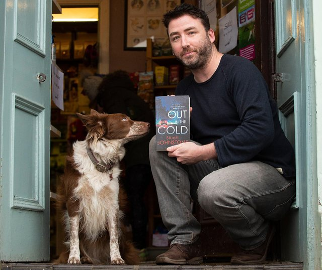 Former policeman and Stockbridge dog shop owner Stuart Johnstone with Holly the dog