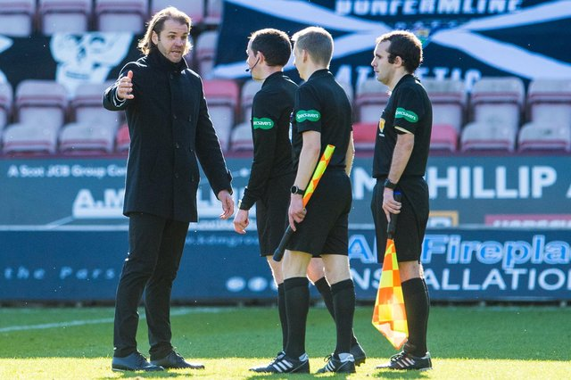 Hearts boss Robbie Neilson speaks to the officials at full-time.
