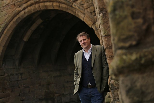 Peter Proud at Dunfermline Abbey - he went to school in the town, and says his early morning milk round taught him key business lessons. Picture: Stewart Attwood.