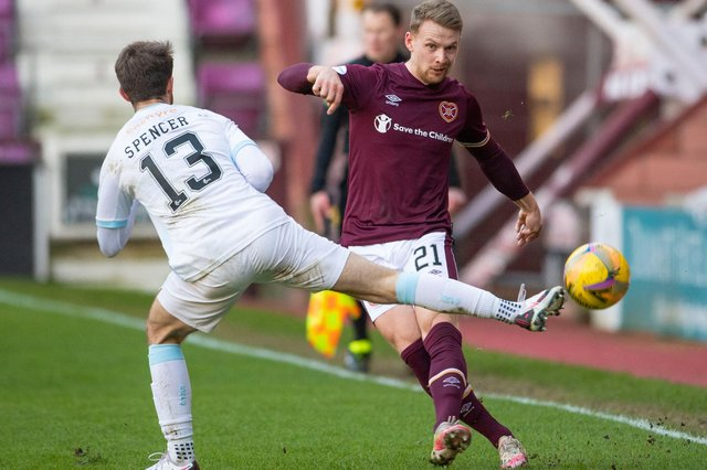 Hearts full-back Stephen Kingsley and Raith Rovers midfielder Brad Spencer in action during Saturday's meeting at Tynecastle. The sides go head-to-head again at Stark's Park this evening. (Photo by Paul Devlin / SNS Group)