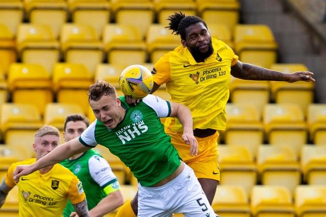 Hibs defender Ryan Porteous battles for an aerial ball with Livingston striker Jay Emmanuel-Thomas