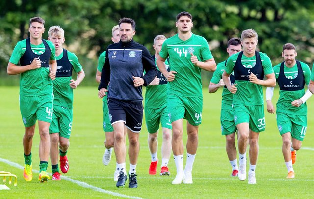Kos Sadiki (#44) trains with the Hibs first team squad at East Mains