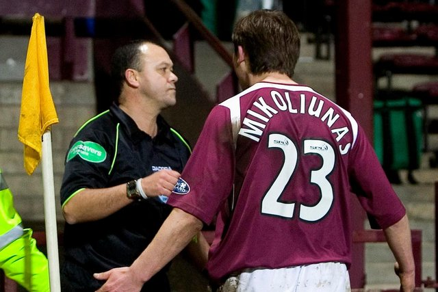 Saulius Mikoliunas bumps linesman Andy Davis after a controversial penalty call, earning a red card and a five-game ban. Picture: SNS