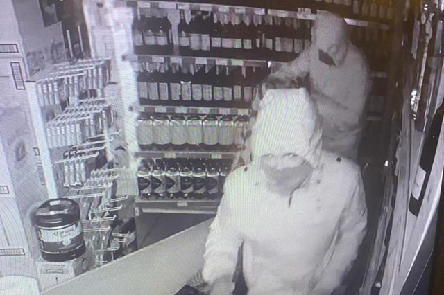 An image from CCTV footage captures the two masked thieves breaking into the Day-Today convenience stores in Drylaw (Photo: Zahid Iqbal).