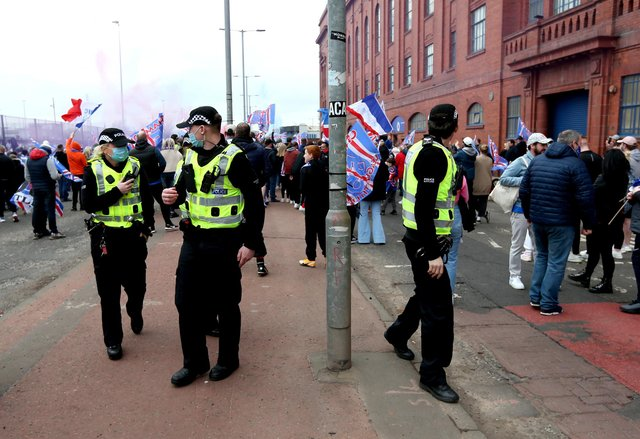 Police arrive at the Ibrox Stadium as fans gather to celebrate Rangers winning the Scottish Premiership title.