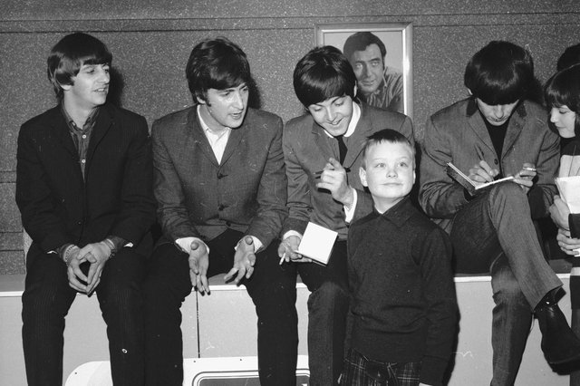 A young fan meets the Beatles at the ABC cinema in Edinburgh in 1964. From left to right: Ringo Starr, John Lennon, Paul McCartney, George Harrison.