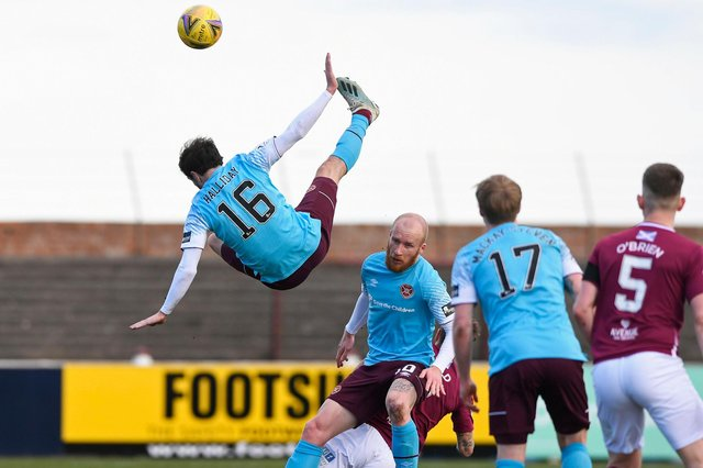 Hearts midfielder Andy Halliday rises above the rest as team-mate Liam Boyce holds off the Arbroath players.