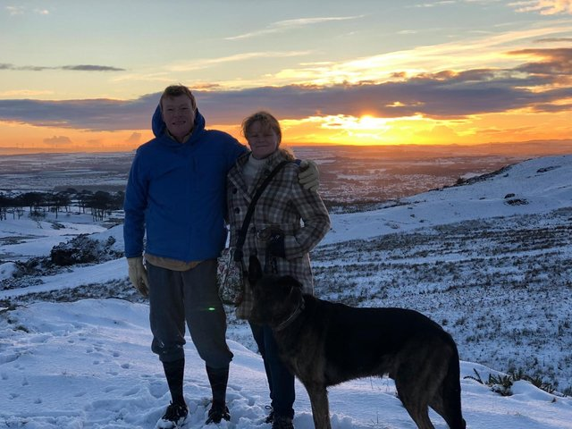 Harry with wife Carrie and dog Corey at Bathgate's Knock Hill