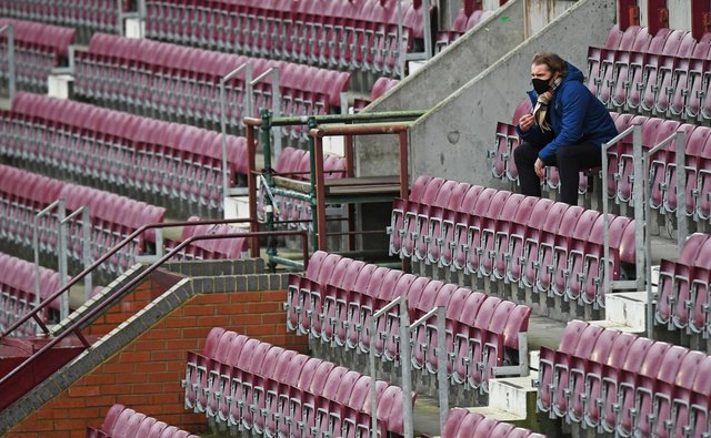 Hearts manager Robbie Neilson sits in the stand at Tynecastle Park.