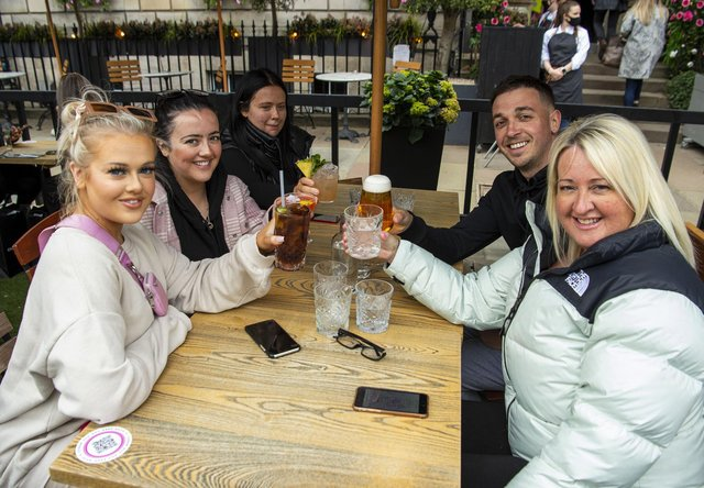 A group of friends enjoying their newfound freedom at Edinburgh's Tigerlily in George Street as drinking alcohol outdoors is permitted from today.