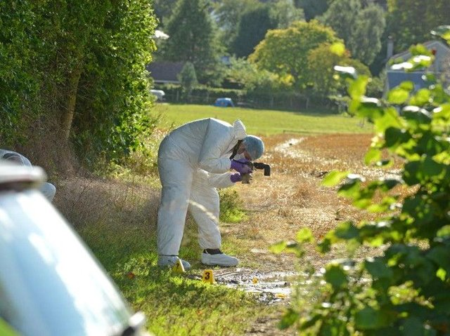 A forensics officer at the scene in Balerno in 2015.